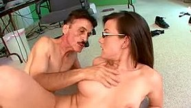 Nerdy brunette with big hooters gets pounded deep by a horny old man